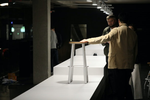 Jason Gregory looking at the Makr Factory Stool in Seoul.
